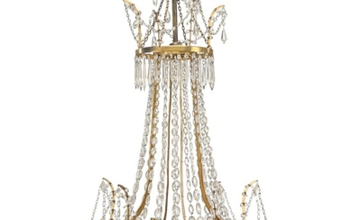 A Louis XVI style four-light crystal chandelier with gilt-brass frame and blue-glass bottom. Early 20th century. H. 90 cm. Diam. 65 cm.