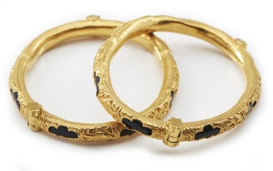 A PAIR OF ANTIQUE GOLD AND BLACK CORAL BANGLES