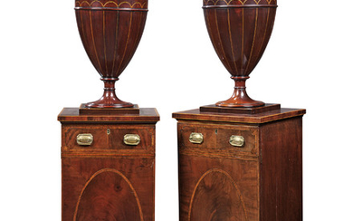 A PAIR OF DINING-ROOM PEDESTALS, GEORGE III, CIRCA 1790, THE URNS ASSOCIATED, ONE OF LATER DATE AND MADE TO MATCH