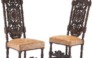 A Pair of French Renaissance-Style Carved Wood and Printed Leather Hall Chairs (20th century)