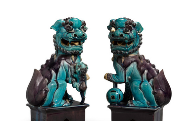 A Pair of Turquoise and Aubergine-Glazed Buddhistic Lions