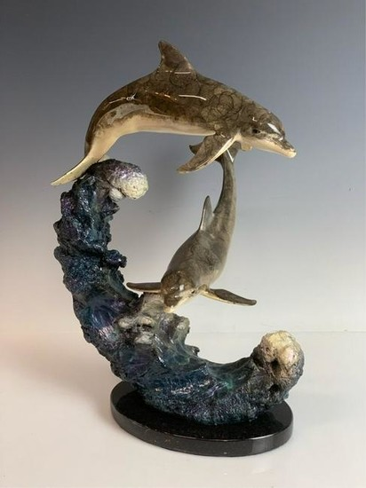 A ROBERT WYLAND BRONZE OF DOLPHINS SURF