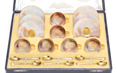 A Royal Worcester boxed coffee set by James Stinton, dated 1919