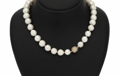 A South Sea pearl necklace set with numerous cultured South Sea pearls and a magnet...