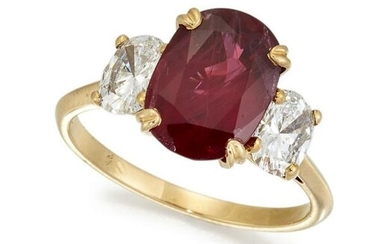 A THREE STONE RUBY AND DIAMOND RING, the oval ruby
