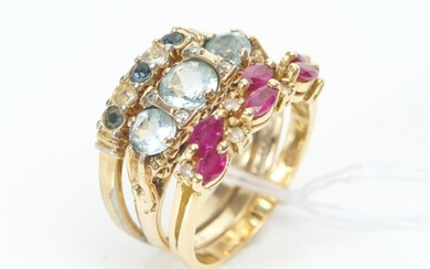 A TRIO OF RINGS INCLUDING AN AQUAMARINE AND DIAMOND HALF HOOP RING IN 9CT GOLD, A RUBY AND DIAMOND RING IN 18CT GOLD AND A COSTUME B...
