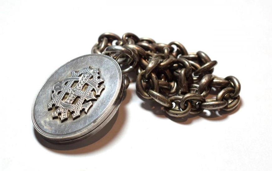 A Victorian locket on chain, locket measures 6.2cm by 4.0cm,...