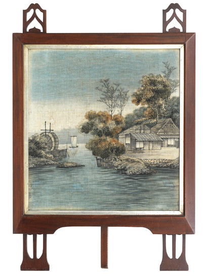 A cut and painted velvet landscape mounted within a European Secessionist fire screen