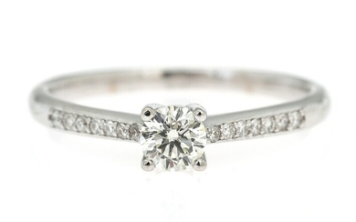 NOT SOLD. A diamond ring set with a brilliant-cut diamond flanked by numerous diamonds, mounted...