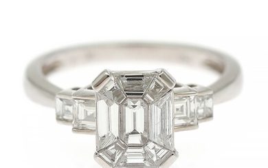 A diamond ring set with a fancy-cut diamond encircled by numerous trapez and square-cut diamonds weighing a total of app. 1.39 ct., mounted in 18k white gold.