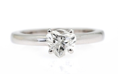 A diamond ring set with a heart-shaped brilliant-cut diamond weighing 0.90 ct., mounted in 18k...