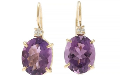 A pair of amethyst and diamond ear pendants each set with an oval-cut amethyst flanked by a diamond, mounted in 18k gold. L. 2.1 cm. (2)