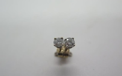 A pair of diamond set stud earrings, each consisting of a ro...