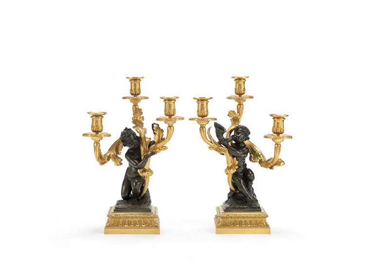 A pair of mid-19th century gilt and patinated bronze three-light figural candelabre