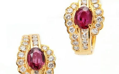 A pair of ruby, diamond and 18k gold earclips