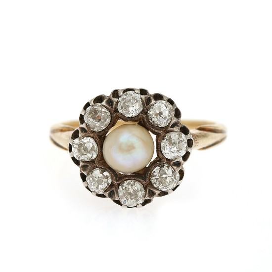 A pearl and diamond ring set with a cultured pearl encircled by eight old-cut diamonds, mounted in 18k gold. Size 57. Circa 1910.