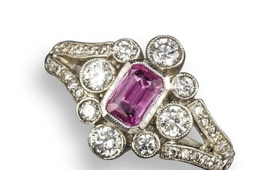 A pink sapphire and diamond cluster ring, centred...