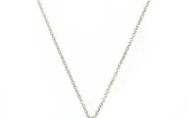 A platinum turquoise and diamond shopping bag pendant/charm by Tiffany & Co.