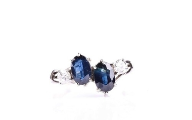 A sapphire and diamond four stone ring, the oval cut sapphir...