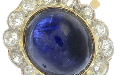 A sapphire cabochon and old-cut diamond cluster ring.