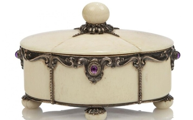 A silver and ivory box and cover with amethyst cabochons...