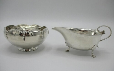A silver sauce boat by Mappin & Webb, Sheffield 1928, with a...