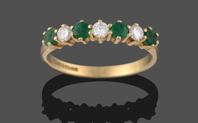 An 18 Carat Gold Emerald and Diamond Seven Stone Ring,...