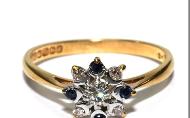 An 18 carat yellow gold ring set with diamonds and sapphire