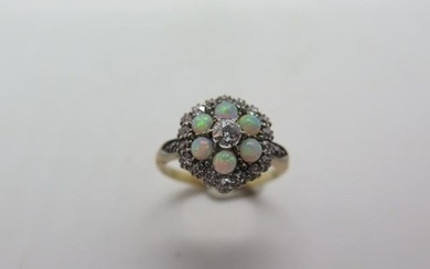 An 18ct yellow gold diamond and opal cluster ring, head appr...