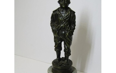 BRONZE FIGURE, of a Boy with his hands in his pockets, on a ...