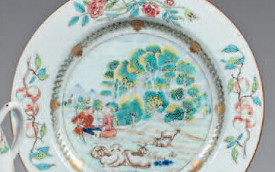 Chinese porcelain plate. Qianlong, early 18th century. Decorated with enamels of the Rose Family, in the center of a couple of shepherds with sheep in a landscape in a medallion with interlaced ribbons and pomegranates, bouquets of roses and peach...