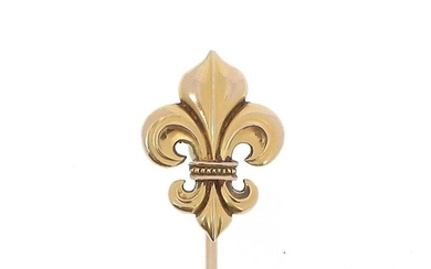 Costume pin in 18k (750 thousandths) yellow gold, the tip decorated with fleur-de-lys.