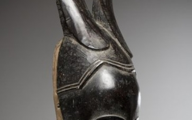 GOURO, Ivory Coast. Antthropomorphic mask with a rounded...