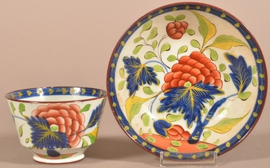 Gaudy Dutch China Grape Pattern Cup and Saucer.
