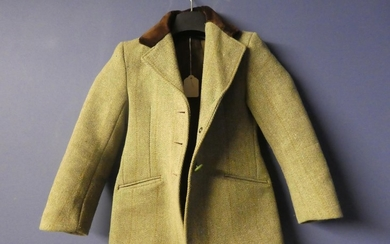 Good quality child's tweed hacking jacket, with brown velvet...