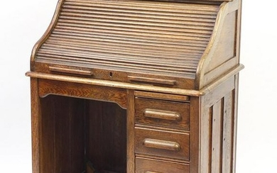 Oak tambour front roll top desk with four drawers to