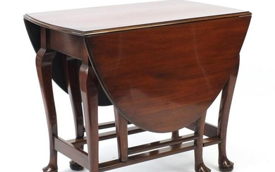 Queen Anne style walnut drop leaf table with pad feet