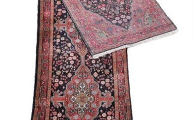 Semi-antique Sarouk runner, classic design with hooked medallions on blue base. Persia. Circa 1960. 516×106 cm.