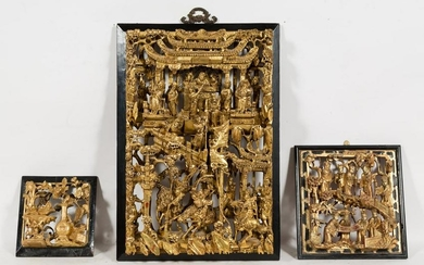 THREE CHINESE CARVED GILTWOOD & LAQUERED PANELS