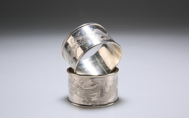 TWO CHINESE SILVER NAPKIN RINGS, of circular form, the