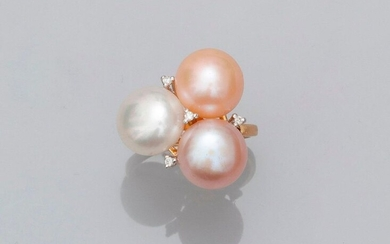 Yellow gold ring, 750 MM, decorated with three freshwater cultured pearls, diameter 7/10 mm enriched with four diamonds, 18 x 20 mm, size: 51, weight: 5.8gr. rough.