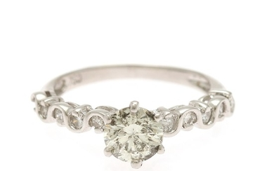 A diamond ring set with a brilliant-cut diamond flanked by ten brilliant-cut diamonds, mounted in 18k white gold. Size 51.