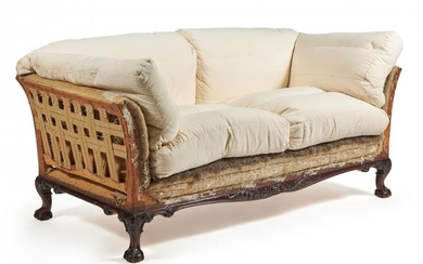 A Victorian carved mahogany sofa by HOWARD & SONS, second half 19th century