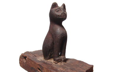 Egyptian wood figure of a seated cat, Late Period