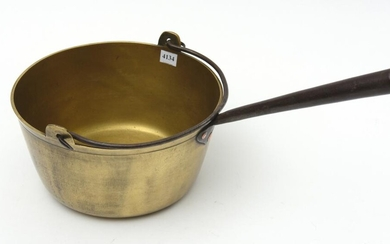 A 19TH CENTURY HEAVY BRASS JAM PAN WITH CAST IRON HANDLE AND HANGER