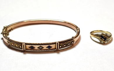 A 9 carat gold sapphire and split pearl bangle; and...