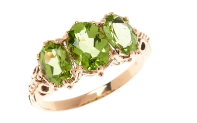 A 9CT GOLD VICTORIAN STYLE PERIDOT RING; set with 3 oval cut peridots in rose gold, size O, wt. 3.25g.