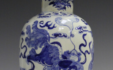 A Chinese blue and white porcelain vase and cover, mark of Kangxi but late 19th century, of baluster