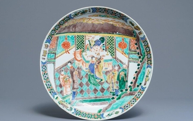 A Chinese famille verte charger with figures in...