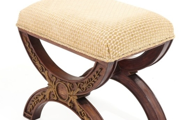 A Directoire style mahogany stained stool, decorated with gilded carvings. 20th-21st century.